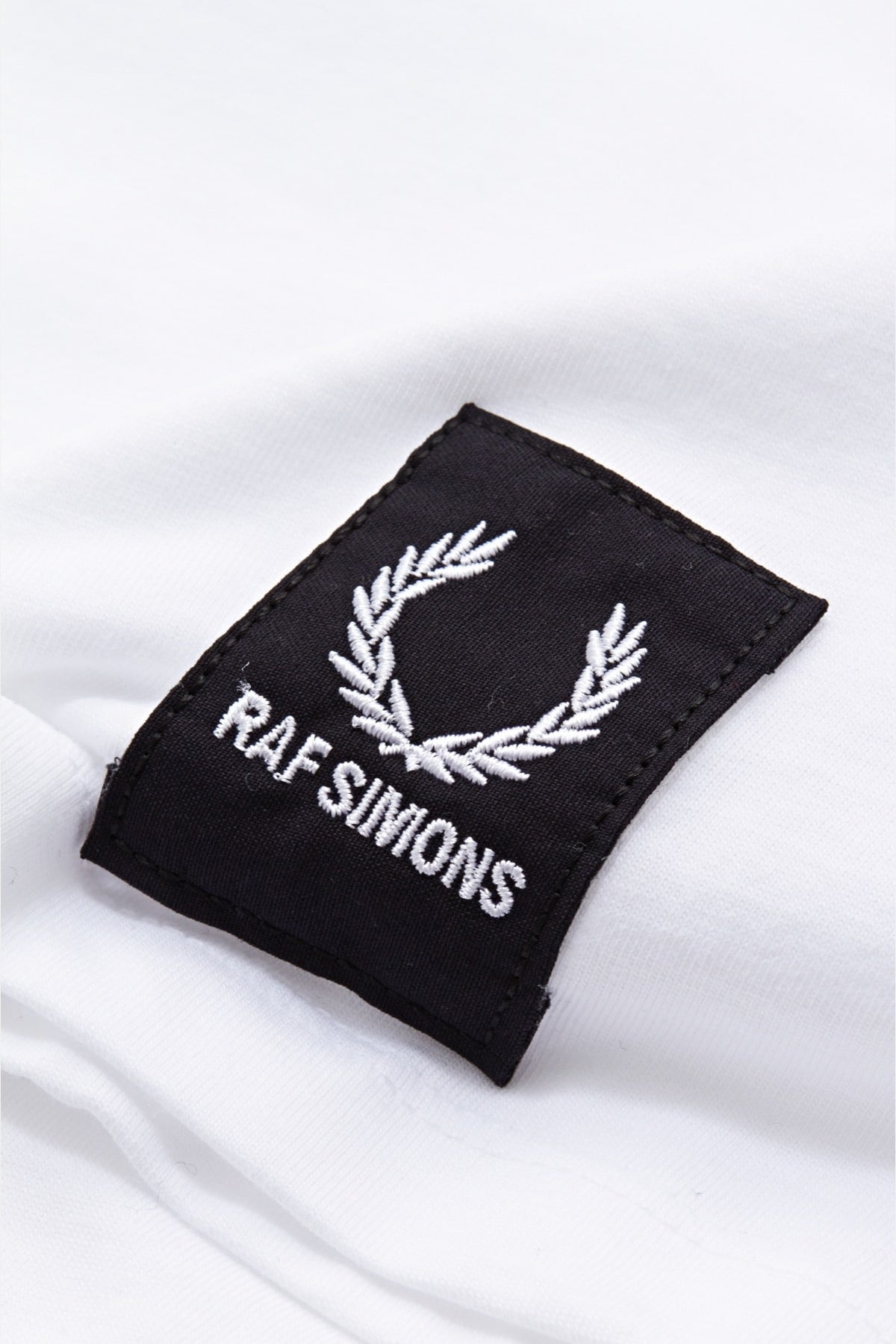 c38c0291f67 Fred Perry x RAF Simons Tape Detail L S T-Shirt available from Priory